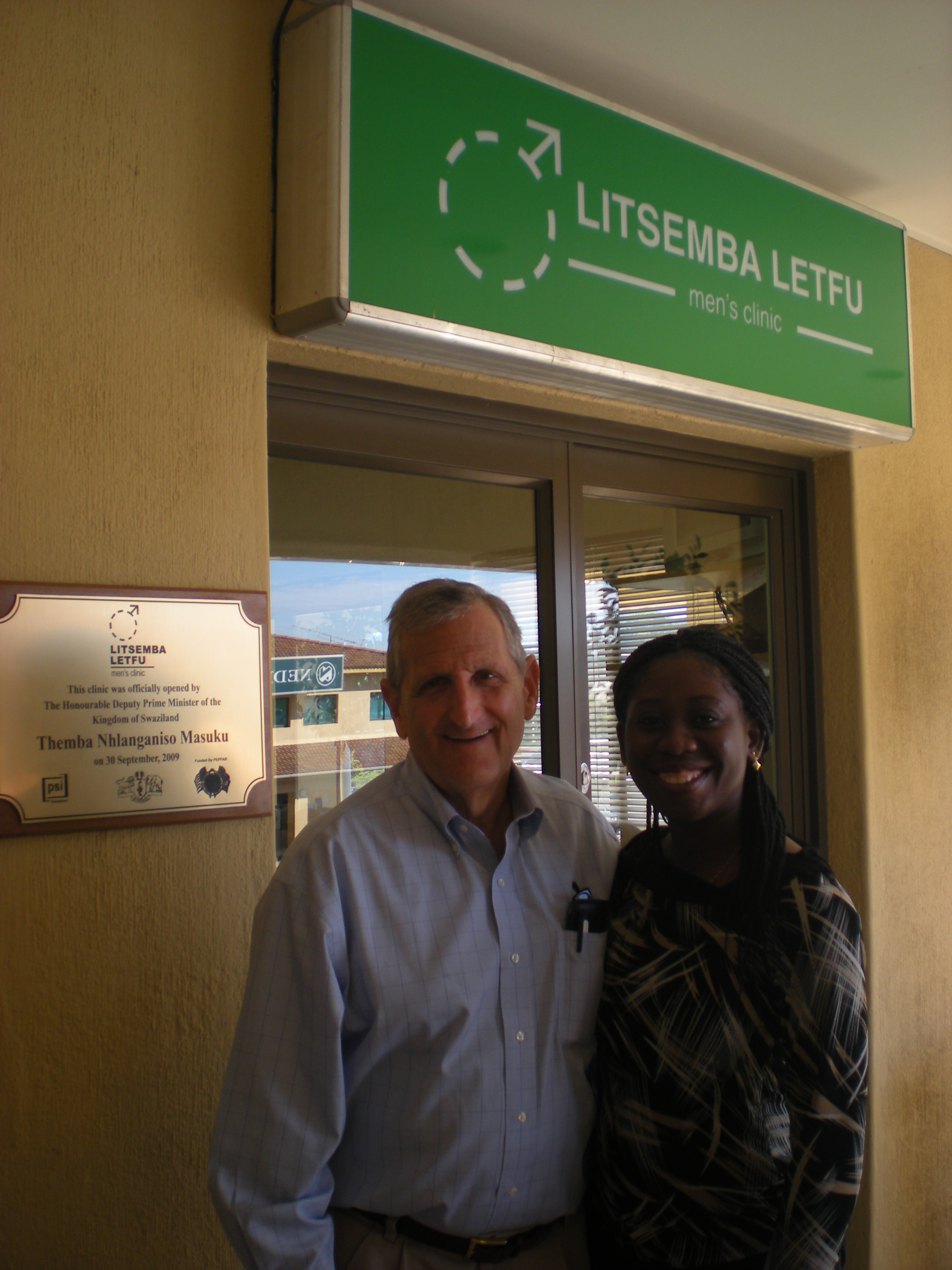 Doctors Ira Sharlip and Winifred Adams stand outside the Litsemba Letfu Clinic (Population Services International/PSI), where volunteers helped perform circumcisions