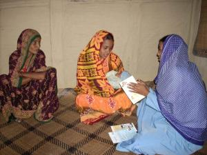 Community health workers, trained in postpartum family planning, visit women in their homes to discuss healthy birth spacing.