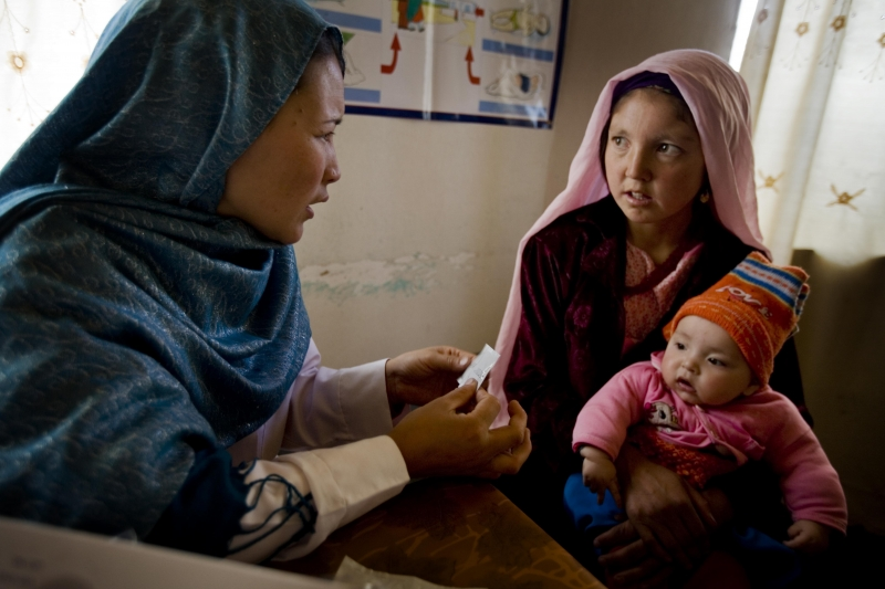 Midwife Sadiqa Husseini counsels a young Afghan mother on healthy birth spacing, which can help reduce maternal and newborn deaths.