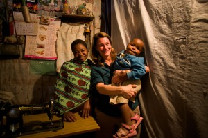 Melinda Gates visits with Mary, a young mother who became a tailor through a Jhpiego-supported program.