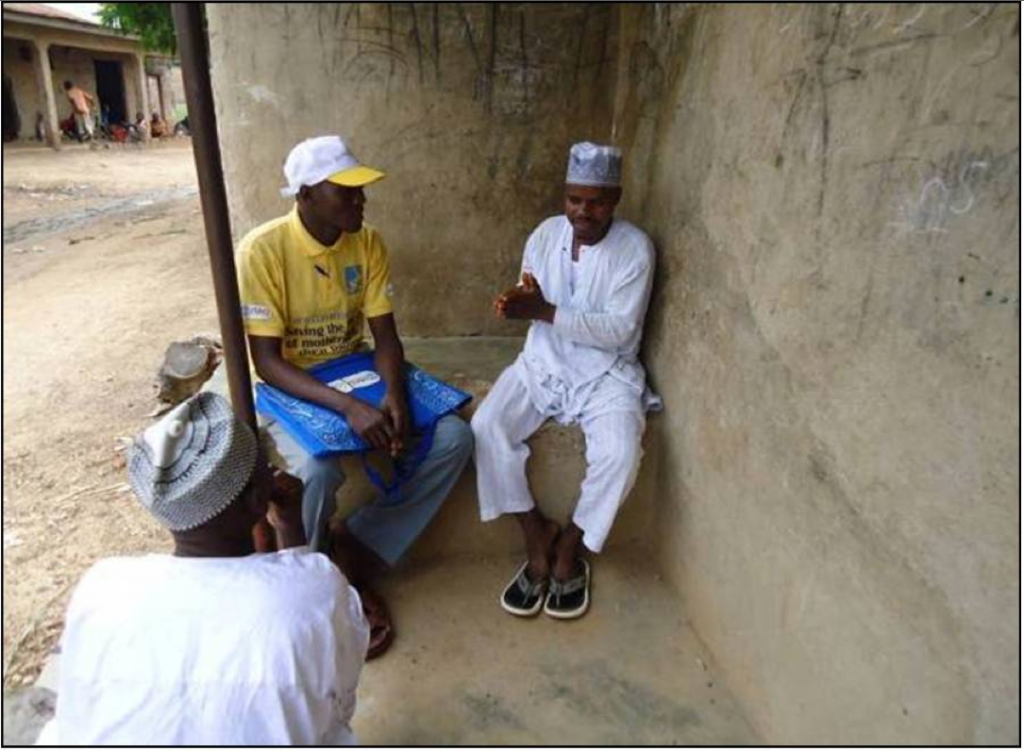 Ali Ibrahim, a male couselor, talks to Abubakar Maikudi, the father of three, about family planning methods.
