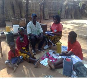 A family in Mozambique is counseled and tested for HIV as part of a government-supported program to increase access to services.