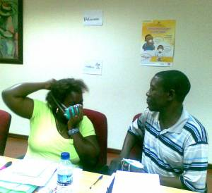 Two Red Cross medical officers learn the proper to put on a respirator.