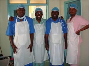 Medical circumcision specialists (l-r) Mbangu Seleji, Evans Chinkoyo, Hatch Kazhila and Andrew Dumingu visit Zambian tribe.