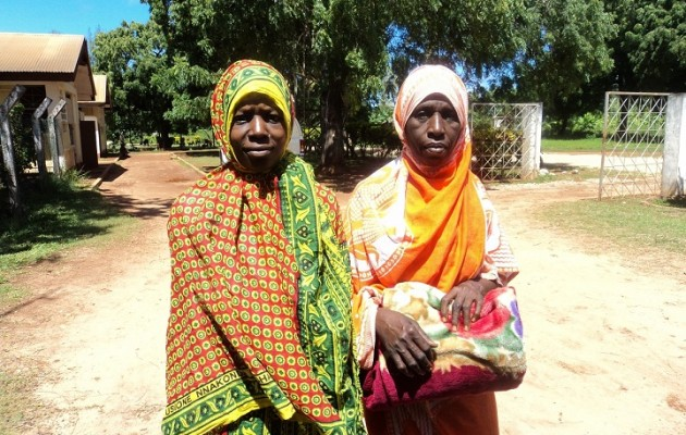 Hidaye Hassan (left) leaves a Zanzibar health center after giving birth to a healthy baby boy.