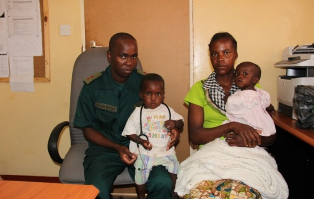 Lt. Brian Lukwesa with Mrs. Banda and her two HIV-negative babies at ZNS Mtetezi camp clinic.