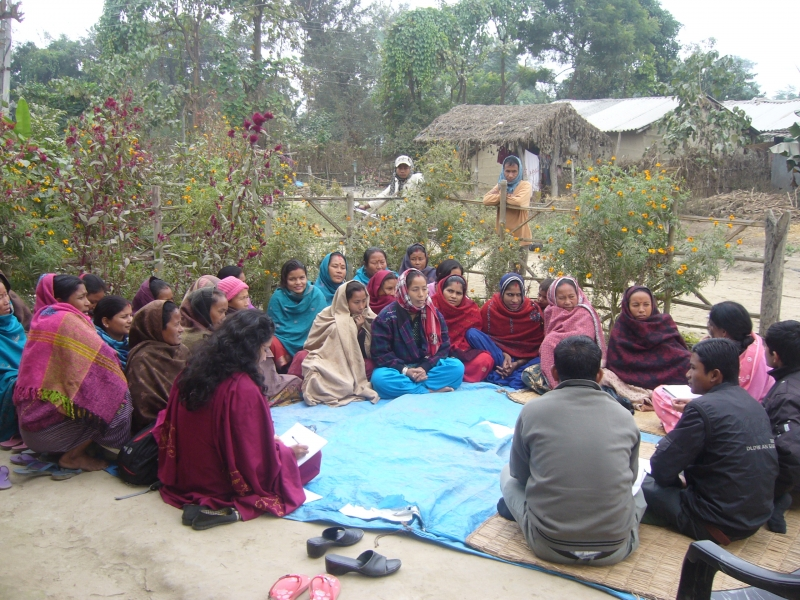 Women meet in a village in southern Nepal to discuss maternal health issues.