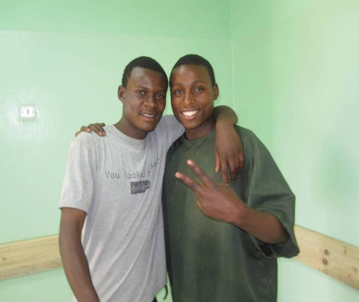 Aaron Hamusonde (left) and his friend Joseph at the clinic to receive counseling on voluntary medical male circumcision.