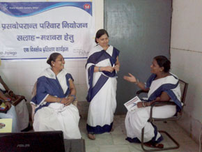 ASHAs participate in role playing during a Jhpiego-supported training on healthy birth spacing.