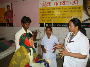 Dr. Kiran Marandi (right profile) and Sister Binderswari, a nurse midwife, are championing postpartum family planning services in the District Hospital in Lohardaga, one of the poorest areas of Jharkhand state. They were trained in these lifesaving services through USAID's flagship global Maternal and Child Health Integrated Program.
