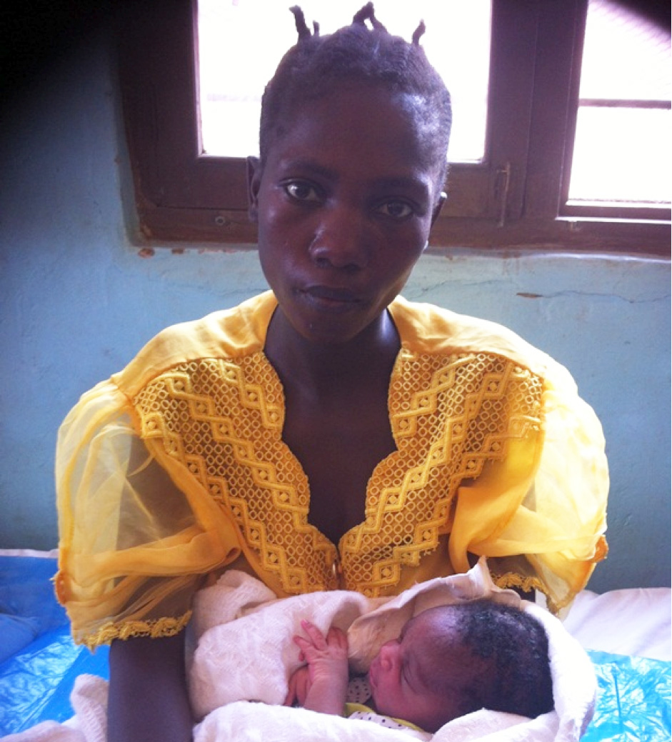 Ashura Baraka, 25, with her new baby girl, Upendo.