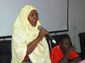 Community health workers Salma Chuma and Selemani Kondo (seated) speak at the inaugural Community Health Workers Initiative meeting.