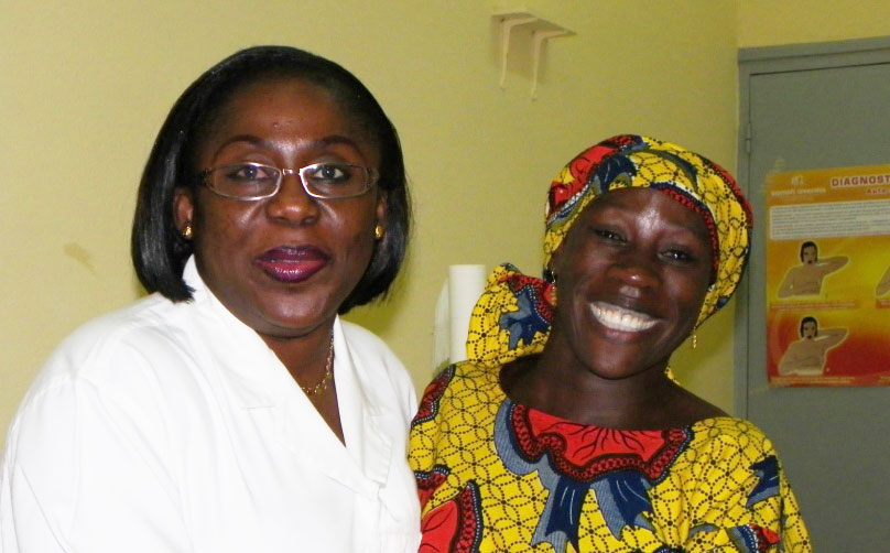 Dr. Annick Ori Zahui, an ob/gyn from Côte d'Ivoire, with her patient, Mariam Cissé, who was treated successfully for a precancerous lesion.
