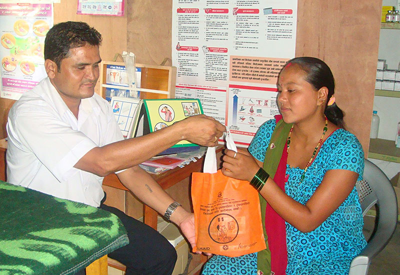 A pregnant woman receives a free supply of calcium at a health facility participating in Nepal's program to prevent pre-eclampsia/eclampsia, the leading cause of maternal deaths in the country.