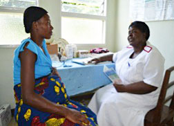 Nurse Abigail using a Jhpiego-developed job aid in conducting individual counseling on FANC and TB with a pregnant woman at Kaporo Rural Hospital in Karonga, Malawi.