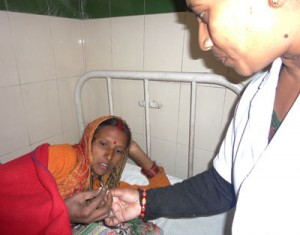 Family Planning Counselor Chandra Bisht shows a client an IUCD that can be inserted following giving birth.