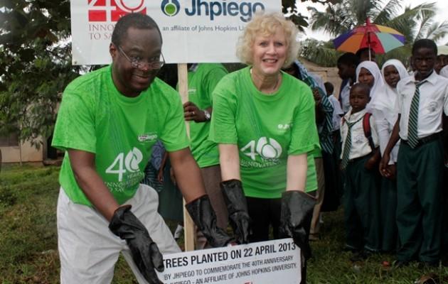 Leslie D. Mancuso and Alain Damiba planting a tree in Tanzania