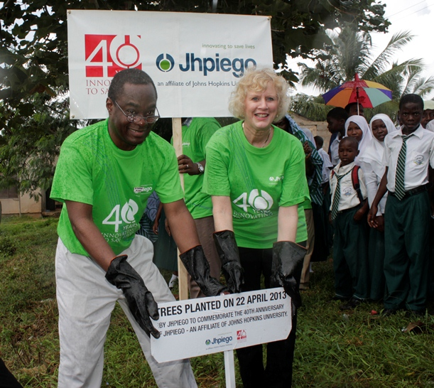 Leslie D. Mancuso and Alain Damiba planting a tree in Tanzania