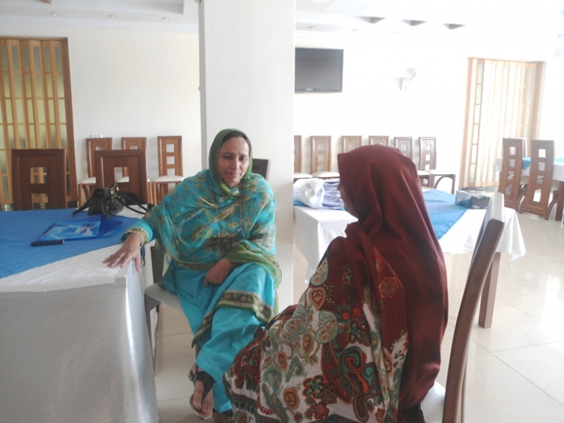 Nurse Midwife Zarina Bibi (left) learns best practices in counseling women on the importance of family planning after birth.