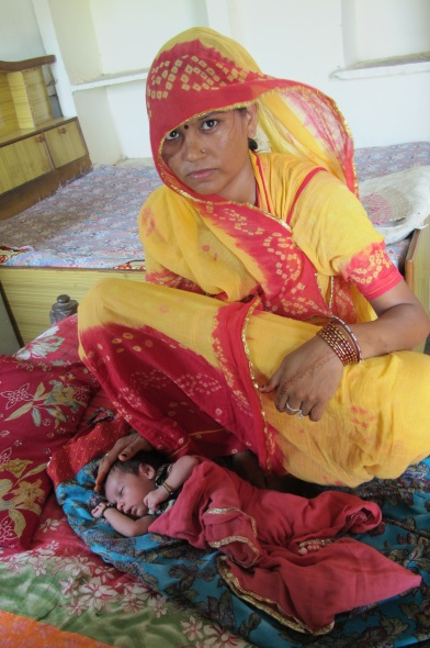 A Safe Childbirth Checklist led a nurse to correctly identify symptoms of pre-eclampsia in Mamta Rajput (shown here) and the young mother received the proper treatment.