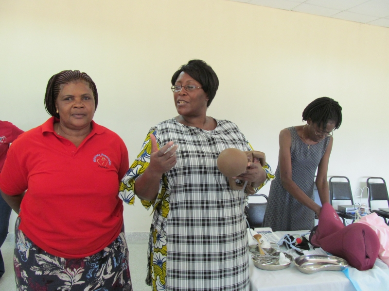 Amafumba and Dr. Christine Kaseba, First Lady of Zambia, during a training session sponsored by an organization supported by the First Lady.
