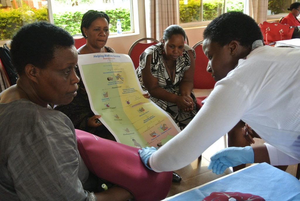 Health workers looking at a poster.