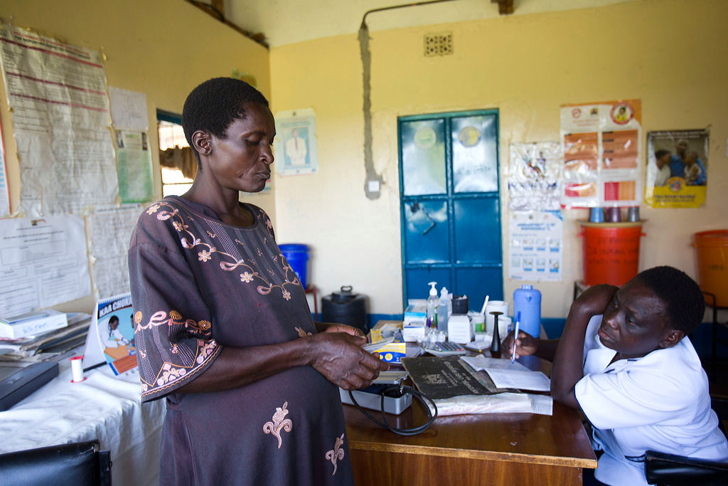 Katharine Aknyi, who is nine months pregnant, receives a malaria prevention medicine at the Got Matar Health Clinic in the Bondo district.
