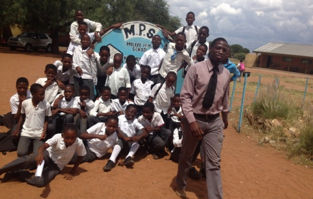 Primary school teacher Mothusi Joseph Kgomo with his students.