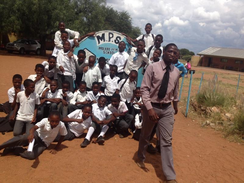 Primary school teacher Mothusi Joseph Kgomo with his students.