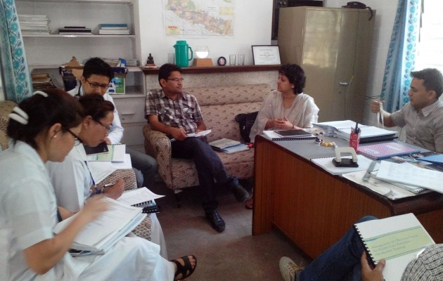 Dr. Kusum Thapa (second from right), Jhpiego's regional training advisor for Asia, discusses with colleagues in Nepal the country's first-ever obstetric fistula repair training package.