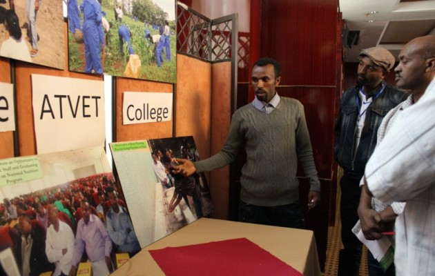 Haile Berihulay explains how Alage ATVET College incorporates the concept of nutrition-sensitive agriculture into their training to other institutions gathered for an annual review meeting on November 20, 2014.