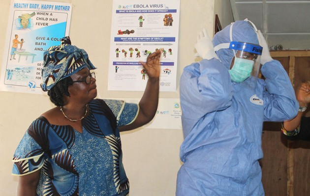 Jhpiego's Liberia team—nurse midwives Marion Subah, Nyapu Taylor, Varwo Sirtor-Gbassie and Comfort Gebeh—lead Infection Prevention and Control training with communities during October 2014 in response to the Ebola crisis in Liberia.