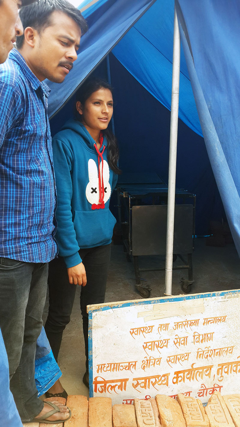 Many health posts in the Nuwakot District collapsed during earthquake, leaving community midwives like Pratima Pokhrel (shown here) to provide services in tents. Jhpiego is working to help 25 such midwives continue providing health services for mothers and babies.