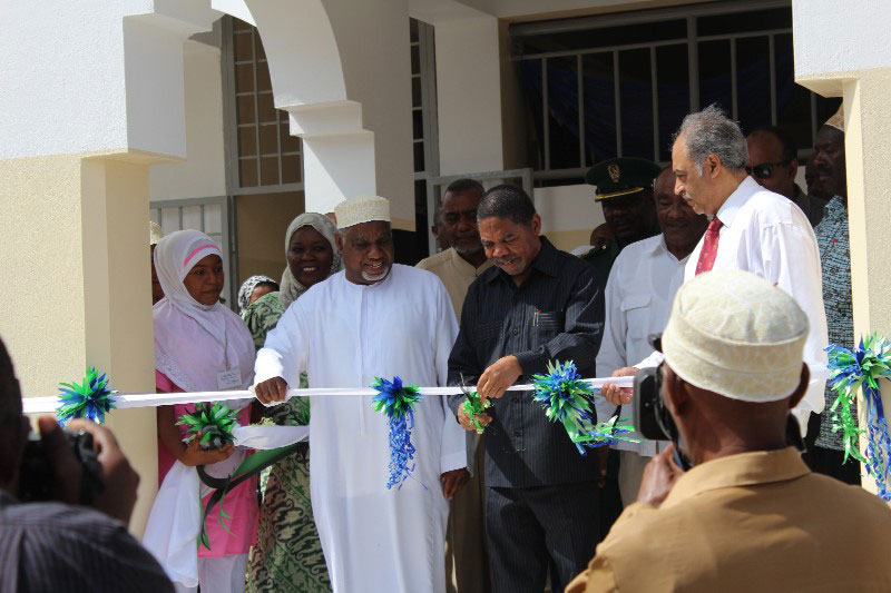 Zanzibar President H.E Dr Shein cuts a ribbon to launch the new Neurosurgery Unit and Center of Excellence at the Mnazi Mmoja Hospital in Zanzibar. Assisting him is Zanzibar Minister for Health Hon. Rashid Seif (in white robe) and Spain's Neurosurgery, Education and Development Foundation (NED, who supported the Unit) representative Dr Mahmoud Quresh (with a red tie).