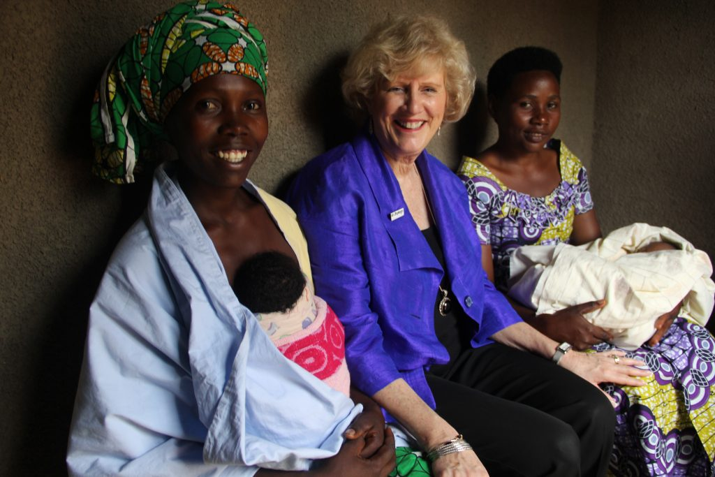 While visiting the Rwamagana District, Jhpiego CEO Leslie Mancuso visits Josiane Mutuyimana and her newborn twins. Community health workers have visited Josiane in her home to follow up on care and feeding of the babies, part of essential routine post-birth care in Rwanda.