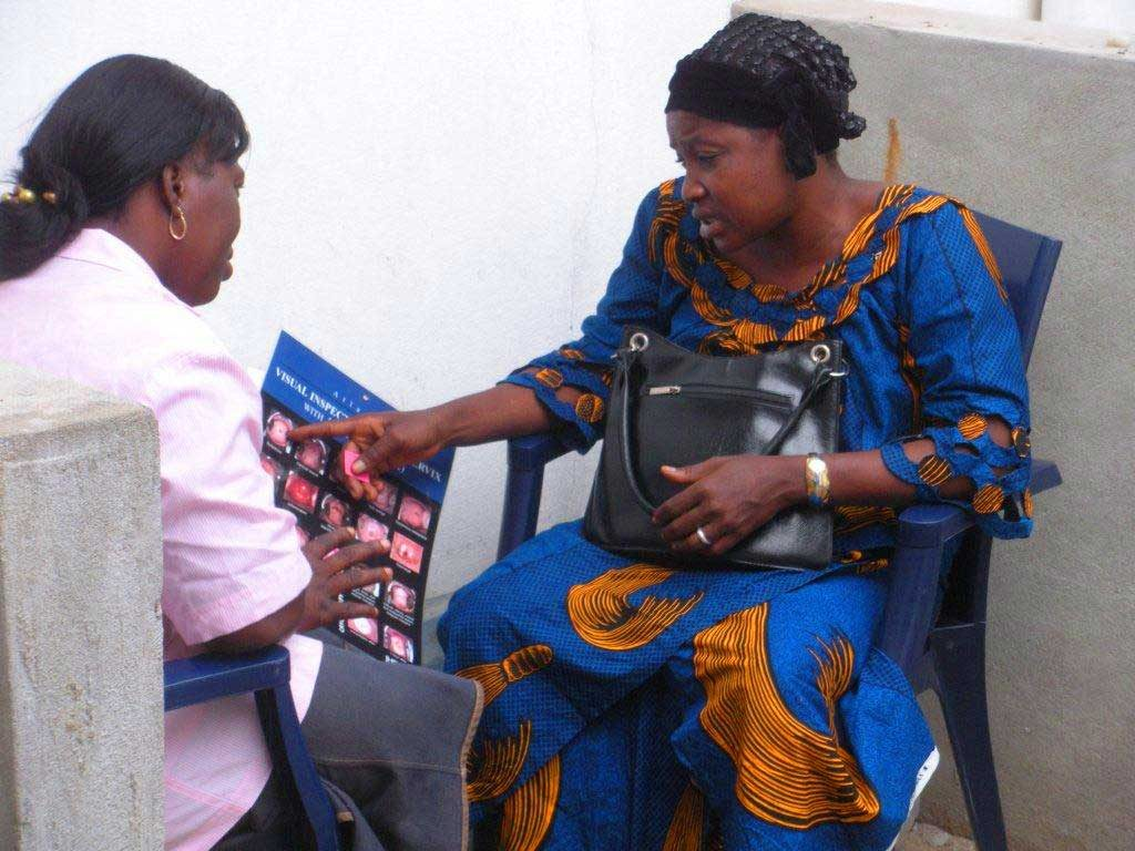 Health worker showing an illustrated chart to a client.