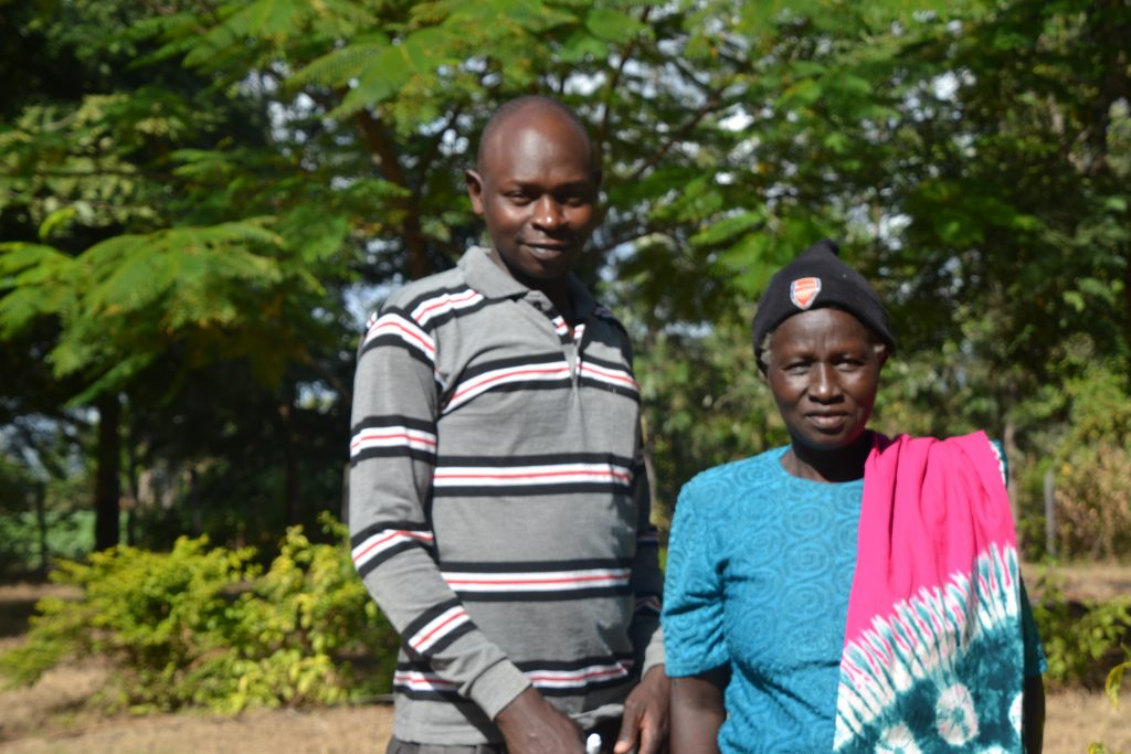 Jane Wairimu, a hypertensive client with Charles Waweru, a community health volunteer assigned to Healthy Heart Africa in Kirinyaga, Kenya.