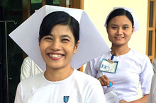 Midwifery instructor Tin Ma Ma Nyein (center) with her students during a break from their studies.