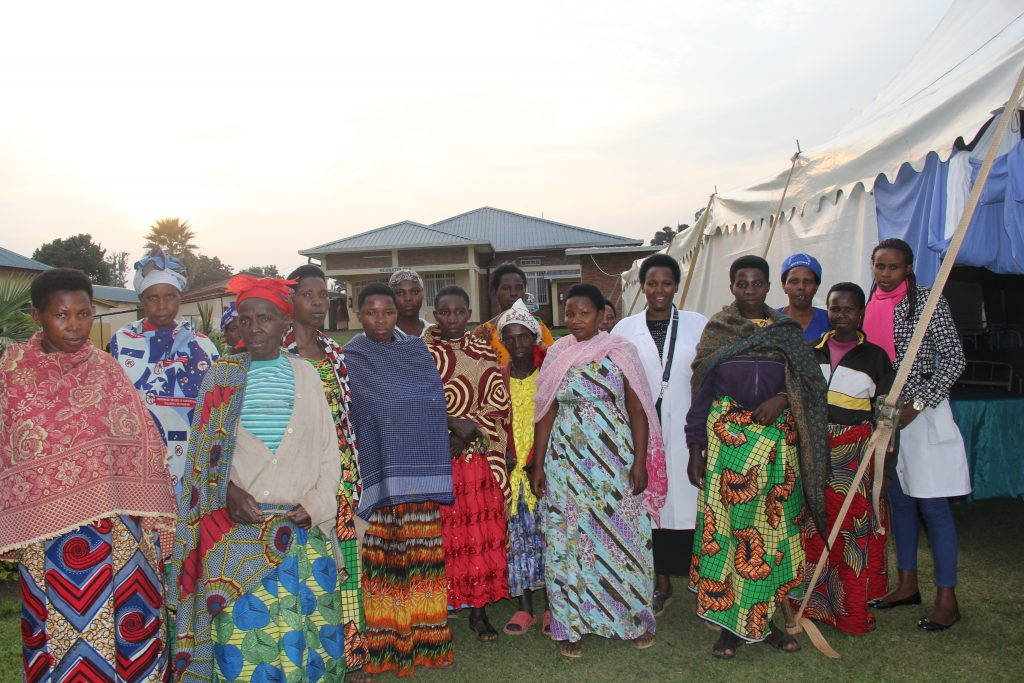 Women arrive at a hospital camp at Ruhengeli Hospital in Musanze, Rwanda, to be screened for surgical repair of obstetric fistula, a devastating childbirth-related condition.
