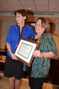 Margarita Gurdian, Chief of Party, receives appreciation certificate from Ambassador La Lime.