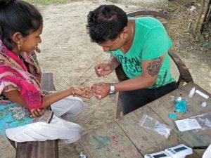 Man and woman sitting during malaria testing