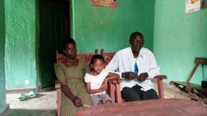 Man, woman and child sitting