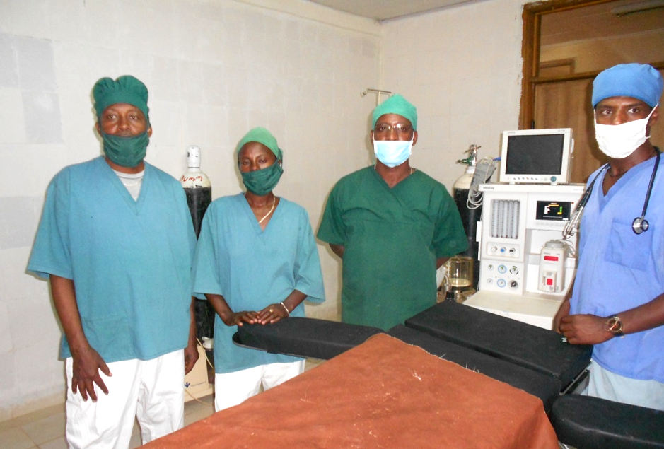 Four health care providers in masks