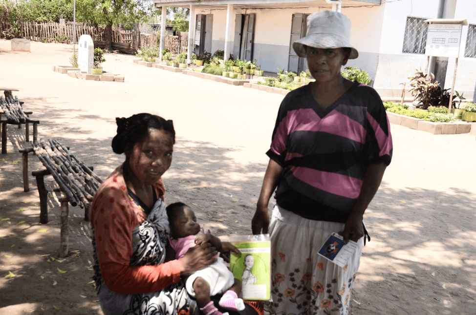 Mother and daughter with community health worker