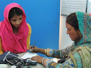 Community midwife Alia with a client