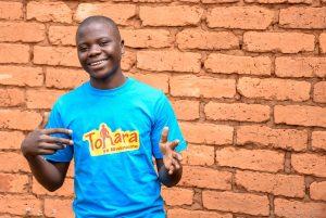 Smiling boy in blue shirt