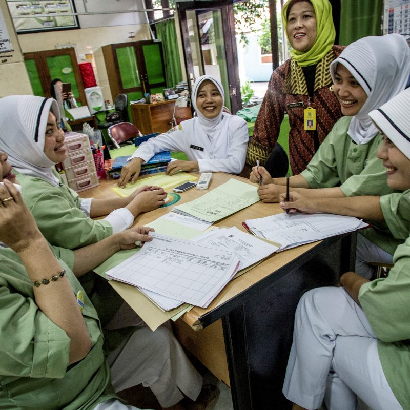 Group of midwives sitting around a table