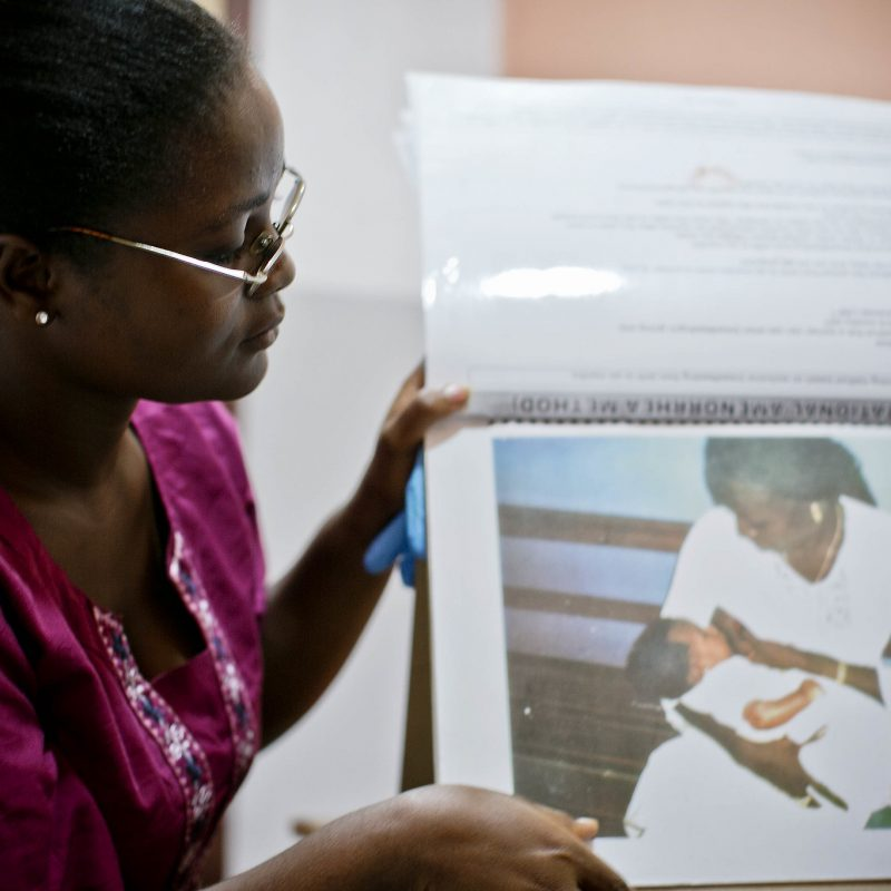 A health worker looking through training materials.
