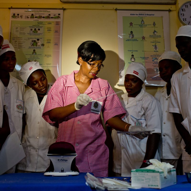 Midwife instructs students.