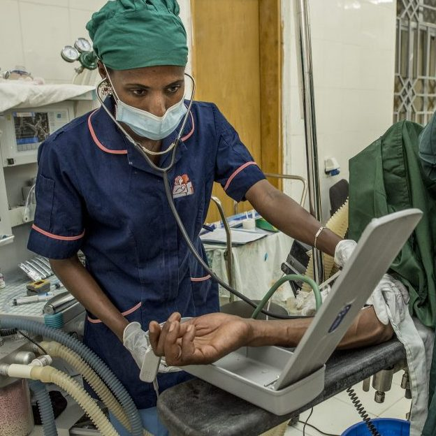 Nurse-anesthesiologist monitoring a patient.